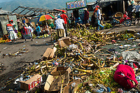Piles of vegetable garbage lie on the floor in the La Saline market, Port-au-Prince, Haiti, 14 July 2008. Every day thousands of women from all over the city of Port-au-Prince try to resell supplies and food from questionable sources in the La Saline market. The informal sector significantly predominate within the poor Haitian economics and the regular shops virtually do not exist. La Saline is the largest street market area in Port-au-Prince.