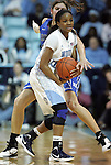 26 February 2012: North Carolina's Brittany Rountree (in white) is defended by Duke's Allison Vernerey (FRA) (behind). The Duke University Blue Devils defeated the University of North Carolina Tar Heels 69-63 at Carmichael Arena in Chapel Hill, North Carolina in an NCAA Division I Women's basketball game.