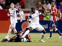Real Salt Lake midfielder Jean Alexandre (12) attempts to move around Chivas USA midfielder Michael Lahoud (11). Real Salt Lake defeated CD Chivas USA 2-1at Home Depot Center stadium in Carson, California on Saturday May 22, 2010.  .