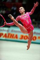 "Inna Zhukova of Belarus begins split leap with hoop at 2008 World Cup Kiev, ""Deriugina Cup"" in Kiev, Ukraine on March 23, 2008."