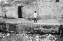 A boy standing in one of the streets of the French colony slum in the city center of Islamabad. The open sewage and garbage cause a constant health risk to the Christian minority inhabiting the slum.