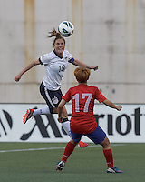 USWNT defender Rachel Buehler (19) heads the ball.  In an international friendly, the U.S. Women's National Team (USWNT) (white/blue) defeated Korea Republic (South Korea) (red/blue), 4-1, at Gillette Stadium on June 15, 2013.