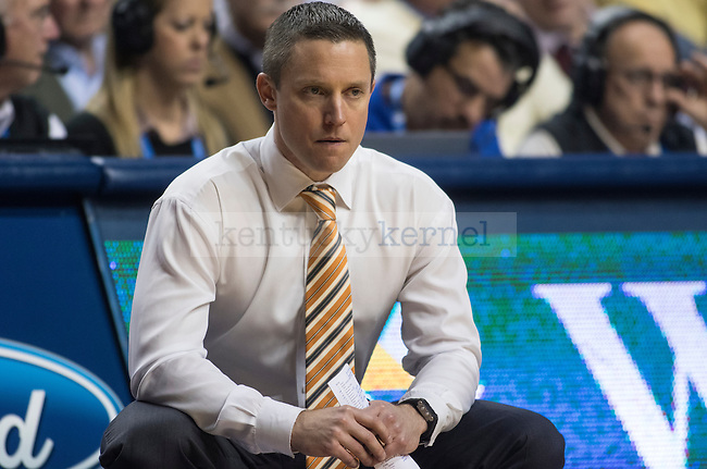 Florida coach Mike White squats on the sidelines during the game against the Florida Gators at Rupp Arena on February 6, 2016 in Lexington, Kentucky. Kentucky defeated Florida 80-61.