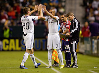 Chicago Fire forward and captain Brian McBride (20) exits the pitch for the last time of his illustrious career is greeted by teammate Calen Carr (3). The Chicago Fire defeated CD Chivas USA 3-1 at Home Depot Center stadium in Carson, California on Saturday October 23, 2010.