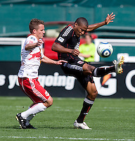 Jordan Graye (16) of D.C. United clears the ball away from Seth Stammler (6) of the New York Red Bulls at RFK Stadium in Washington, DC.  The New York Red Bulls defeated D.CC United, 2-0.