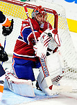 26 October 2009: Montreal Canadiens' goaltender Jaroslav Halak juggles the puck to make a save in overtime against the New York Islanders at the Bell Centre in Montreal, Quebec, Canada. The Canadiens defeated the Islanders 3-2 in sudden death overtime for their 4th consecutive win. Mandatory Credit: Ed Wolfstein Photo