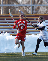 Boston University midfielder Ally Adams (15) on the attack as Boston College defender Molly Erdle (16) defends..Boston College (white) defeated Boston University (red), 12-9, on the Newton Campus Lacrosse Field at Boston College, on March 20, 2013.