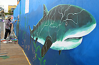 Artist Janet Wallace paints a mural at the Santa Monica Pier on Tuesday, February 7, 2012.