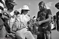 Janet Guthrie signs autographs after a 1976 USAC Champ Car race at Michigan International Speedway near Brooklyn, Michigan, USA.
