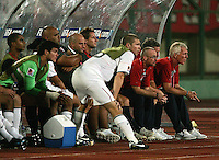 The United States' bench, including head coach Thomas Rongen, right, watches the match against South Korea during the FIFA Under 20 World Cup Group C match between the United States and South Korea at the Mubarak Stadium on October 02, 2009 in Suez, Egypt. The US team lost 3-0.