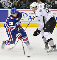 Rochester Americans right wing Alex Hutchings, left, evades San Antonio Rampage defenseman Josh McFadden in the first period of an AHL hockey game, Saturday, Jan. 18, 2014, in San Antonio (Darren Abate/AHL)