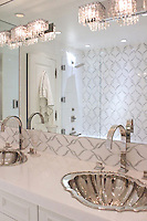 This custom bathroom backsplash features Sophie, a handmade mosaic  shown in polished Calacatta Tia and honed Thassos, a part of the Silk Road Collection by Sara Baldwin for New Ravenna.<br />