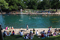 Barton Springs Pool offers perfect setting for swimming laps, snorkeling while exploring the natural limestone pool bed.