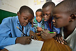 Refugee boys work together on an assignment in class in a school operated by St. Andrew's Refugee Services in Cairo, Egypt. Located at St. Andrews United Church of Cairo, the program is supported by Church World Service.