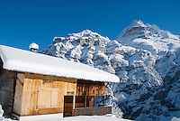 Snow covered house with view of Jungfrau and the Swiss alps
