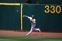 OAKLAND, CA - MAY 27:  Matt Holliday #5 of the Oakland Athletics makes a throw from left field against the Seattle Mariners during the game at Oakland-Alameda County Coliseum on May 27, 2009 in Oakland, California. Photo by Brad Mangin