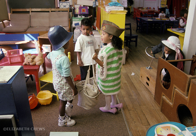 Albany, CA Preschool kids three to four years old in fantasy play with one girl running the game