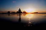 Silhouetted man on the beach at Tofino . Vancouver island, British Colombia, Canada.