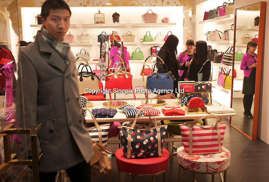 Chinese customers shop at a newly opened Kate Spade store in Sanlitun, Beijing, China. 11-Jan-2014