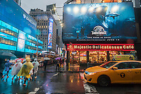 """Advertising in Times Square in New York for the summer blockbuster hit """"Jurassic World"""", seen on Tuesday, June 2 2015. The film is the fourth in the series and opens 22 years after the original.  """"Jurassic World"""" opens on June 12.  (© Richard B. Levine)"""