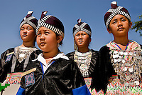 Young girls dressed in traditional Asian attire prepare to dance during the Charlotte Dragonboat Association racing on Lake Norman in NC.