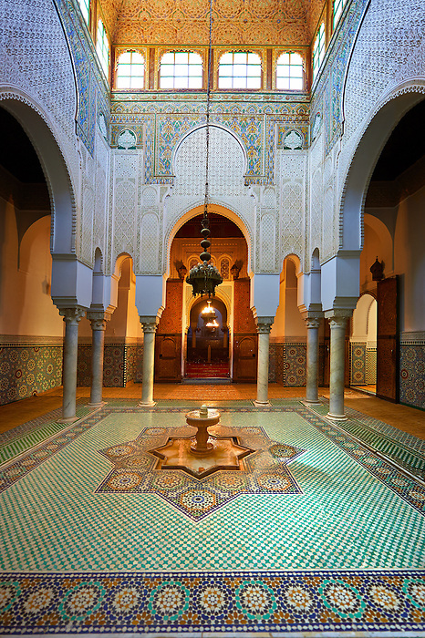 Inner fountain courtyard with Berber Mocarabe Honeycomb work plaster decorations and Berber design tiles of the Mauseleum of Moulay Ismaïl Ibn Sharif , reigned 1672–1727. A UNESCO World Heritage Site .Meknes, Meknes-Tafilalet, Morocco.