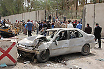 BAGHDAD, IRAQ:  A wrecked car outside the Iranian Embassy after car bombs go off in Baghdad...Three car bombs hit the centre of the Iraqi capital, Baghdad, in quick succession, killing at least 30 people and injuring about 160 people.  The bombs appeared to target the Iranian embassy, and the Egyptian, Syrian and German missions in Iraq.