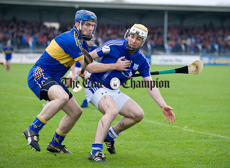James Mc Inerney of Newmarket On Fergus in action against Conor Mc Grath of Cratloe during the senior county hurling final at Cusack Park. Photograph by John Kelly.