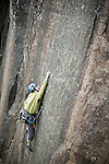 A climber reachs for a hand hold while climbing at Poke - O - Moonshine.