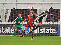 Mike Magee (9) of the Chicago Fire heads the ball against Daniel Woorlad (21) of D.C. United.  The Chicago Fire defeated D.C. Untied 3-0, at RFK Stadium, Friday October 4 , 2013.
