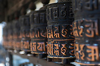 Close up of prayer wheels at the Swayambhunath, an ancient religious complex atop a hill in the Kathmandu Valley, west of Kathmandu city. It is also known as the Monkey Temple as there are holy monkeys living in the north-west parts of the temple.