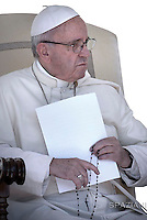 Pope Francis prays rosary for the earthquake victims in Central Italy during the wednesday general audience in St. Peter's Square at the Vatican. on August 24, 2016.