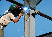 Worker welding steel beams. Huntsville Alabama.