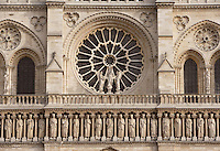 The Kings? Gallery, composed of 28 statues representing the Kings of Juda and Israël, above, Rose window of 10 meters in diameter with the group of sculptures of the virgin, Notre Dame de Paris, known simply as Notre Dame, 1163 ? 1345, initiated by the bishop Maurice de Sully, Ile de la Cité, Paris, France. Picture by Manuel Cohen