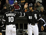 CHICAGO - APRIL 12:  Alexei Ramirez #10 is greeted by Alex Rios #51 of the Chicago White Sox after Ramirez hit the first of two home runs against the Oakland Athletics on April 12, 2011 at U.S. Cellular Field in Chicago, Illinois.  The White Sox defeated the Athletics 6-5.  (Photo by Ron Vesely)  Subject:  Alex Rios;Alexei Ramirez