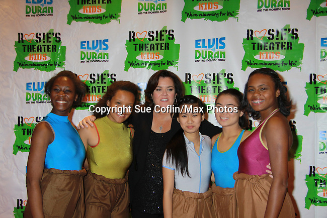 """Rosie's Kids - the Seniors pose with All My Children's Rosie O'Donnell """"Naomi - The Maid"""" hosted Rosie's Building Dreams for Kids Gala benefitting Rosie's Theater Kids on September 19, 2011 at New York Marriott Marquis, New York City, New York. (Photo by Sue Coflin/Max Photos)"""