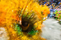 A dancer of Mocidade samba school performs during the Carnival parade at the Sambadrome in Rio de Janeiro, Brazil, 20 February 2012. The Carnival in Rio de Janeiro, considered the biggest carnival in the world, is a colorful, four day celebration, taking place every year forty days before Easter. The Samba school parades, featuring thousands of dancers, imaginative costumes and elaborate floats, are held on the Sambadrome, a purpose-built stadium in downtown Rio. According to costumes, flow, theme, band music quality and performance, a single school is declared the winner of the competition.