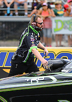 Jul 23, 2016; Morrison, CO, USA; Crew member for NHRA funny car driver Alexis DeJoria during qualifying for the Mile High Nationals at Bandimere Speedway. Mandatory Credit: Mark J. Rebilas-USA TODAY Sports