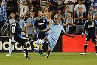 Birahim Diop (blue) Sporting KC midfielder clears the ball past Simon Dawkins San Jose Earthquakes... Sporting KC defeated San Jose Earthquakes 1-0 at LIVESTRONG Sporting Park, Kansas City, Kansas.