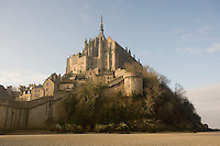The Ramparts, remarkable example of 15th century military architecture, constructed mostly during the Hundred Years War, surrounding the Merveille (Marvel), 13th century, thanks to a donation by the king of France, Philip Augustus who offered Abbot Jourdain, a grant for the construction of a new Gothic-style architectural set, Le Mont Saint Michel, Manche, Basse Normandie, France. A parapet resting on corbelled machicolations crowns both towers and walls. Picture by Manuel Cohen
