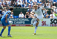Roman Pavlyuchenko (right)  kicks the ball against Joey Gjertsen (left). San Jose Earthquakes tied  Tottenham Hotspur 0-0 at Buck Shaw Stadium in Santa Clara, California on July 17th, 2010.