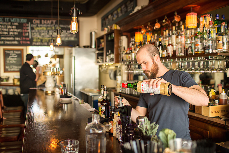 Hillsborough, North Carolina - Thursday January 21, 2016 - LaPlace bartender Robby Dow makes The Silk Road, a cocktail Dow created featuring curry-infused Chartreuse. The drink is a take on the cocktail, The Last Word.