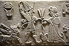 """Photo of Neo-Hittite orthostat from Karkamis, Turkey. Ancora Archaeological Museum.  The meeting of the """"Storm God"""" on right and a King on the left. 1"""