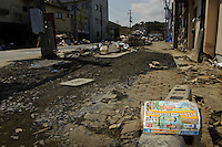A manga boat and debris filled street, Ishinomaki, Miyagi Prefecture, Japan, May 5, 2011. Almost two months after the devastating earthquake and tsunami the reconstruction has barely begun.