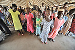 Children participate as the congregation prays during Sunday morning worship at the United Methodist Church in Yei, a town in Central Equatoria State in Southern Sudan.