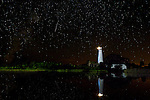 A meteor streaks through the night sky at the St Marks Lighthouse in the St Marks National Wildlife Refuge in St Marks, Florida during the Perseid Meteor Shower.<br /> <br /> CREDIT: MarkWallheiser.com