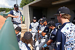 31 May 2016: Nova Southeastern head coach Greg Brown (left) talks to his team during a lightning delay. The Nova Southeastern University Sharks played the Lander University Bearcats in Game 8 of the 2016 NCAA Division II College World Series  at Coleman Field at the USA Baseball National Training Complex in Cary, North Carolina. Nova Southeastern won the game 12-1.