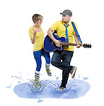 Man with a guitar and a woman dancing in a puddle with splashes of water around them. Isolated on white background.