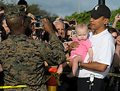 Kailua, Hawaii - December 31, 2008 -- United States President-elect Barack Obama holds Peyton Highfill, 9 months, as he greets well-wishers after his morning workout at Semper Fit Center gym in Marine Corps Base Hawaii at Kaneohe Bay in Kailua, Hawaii on Wednesday, December 31, 2008. Obama and his family arrived in his native Hawaii December 20 for the Christmas holiday..Credit: Joaquin Siopack - Pool via CNP