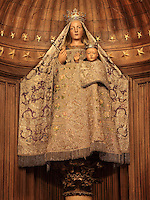 Notre dame du Pilier or Our Lady of the Pillar, a wooden sculpture of the Virgin and Child atop a pillar with carved capital, c. 1540, in the Chapel of Notre Dame du Pilier, ambulatory, Chartres Cathedral, Eure-et-Loir, France. Chartres cathedral was built 1194-1250 and is a fine example of Gothic architecture. It was declared a UNESCO World Heritage Site in 1979. Picture by Manuel Cohen